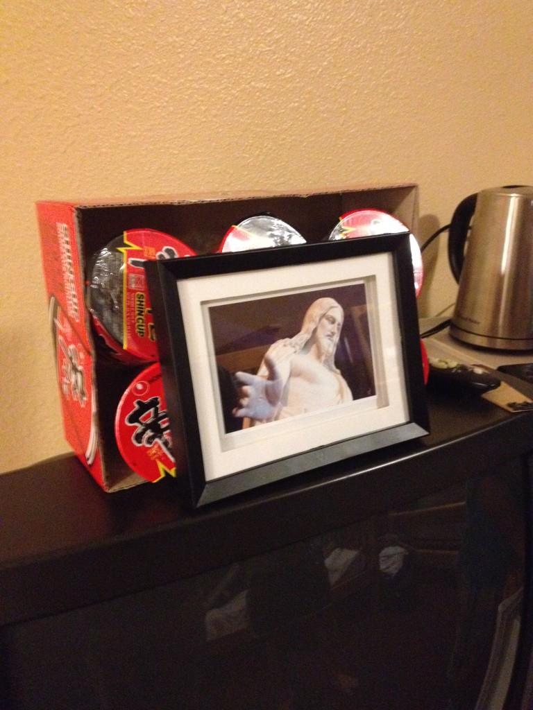 """One of our """"sons"""" brought cases of noodles with him, so we called the boys' room the """"noodle party room"""". Loved how he then propped up a picture of Christ against the noodles!"""